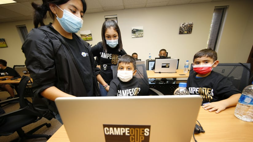 Children from the OHC test out their new computers
