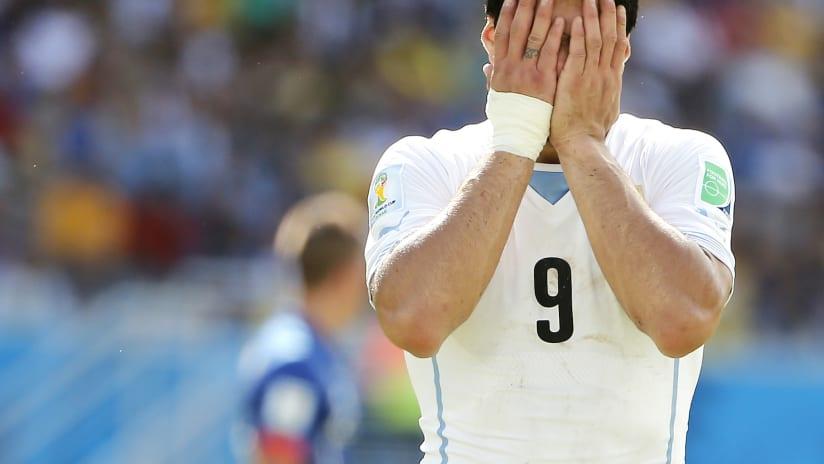 Suarez Head in Hands