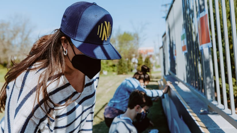 Nashville SC, Local Volunteers Paint Mural at New Community Soccer Pitch at TIRRC Headquarters