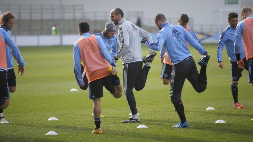 Oscar Pitillas leads stretching