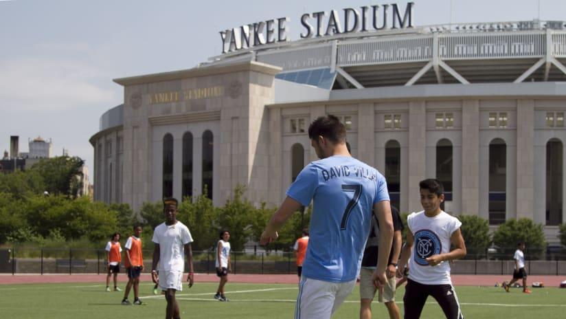 David Villa with kids in Yankee Stadium