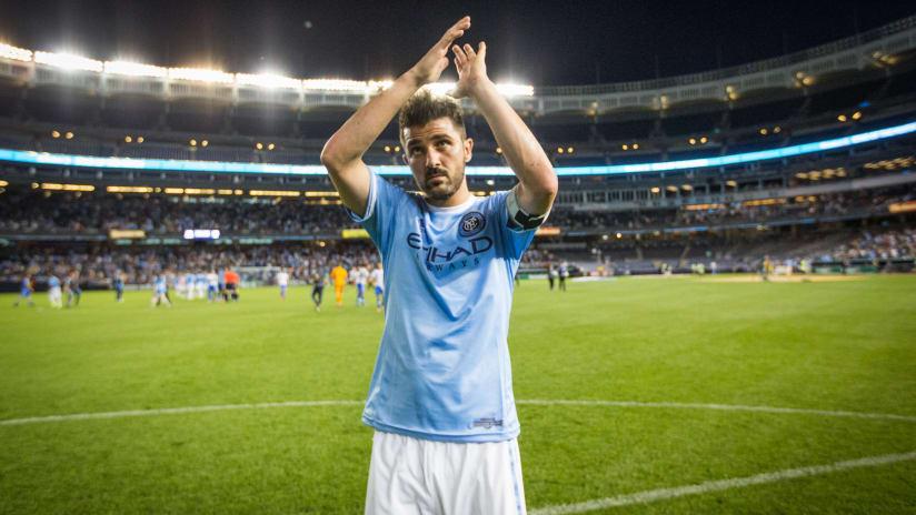David Villa applauds fans