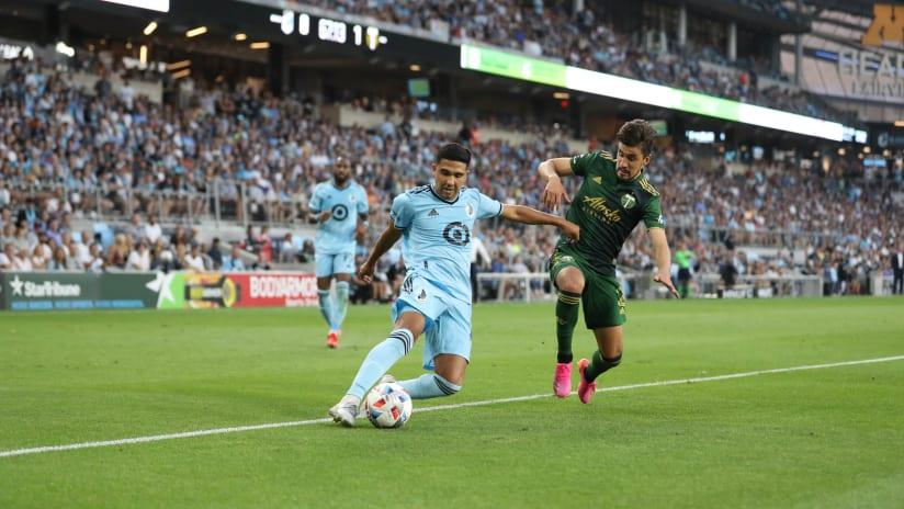 Josecarlos Van Rankin defends against a Minnesota United player in the Portland Timbers' 2-1 loss (July 24, 2021)