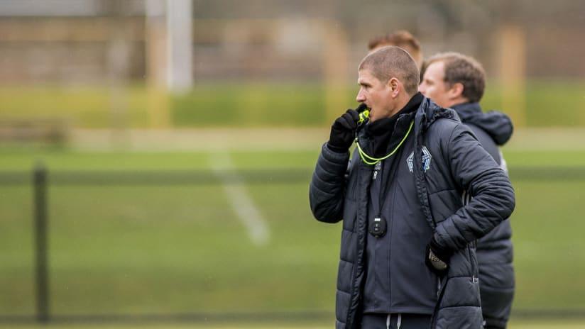 Robinson blowing whistle at training - big jacket