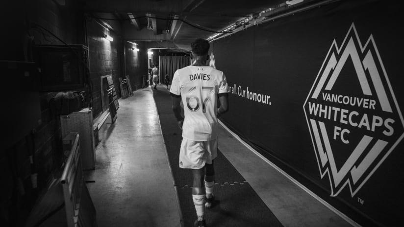 Davies - tunnel - back - walking away