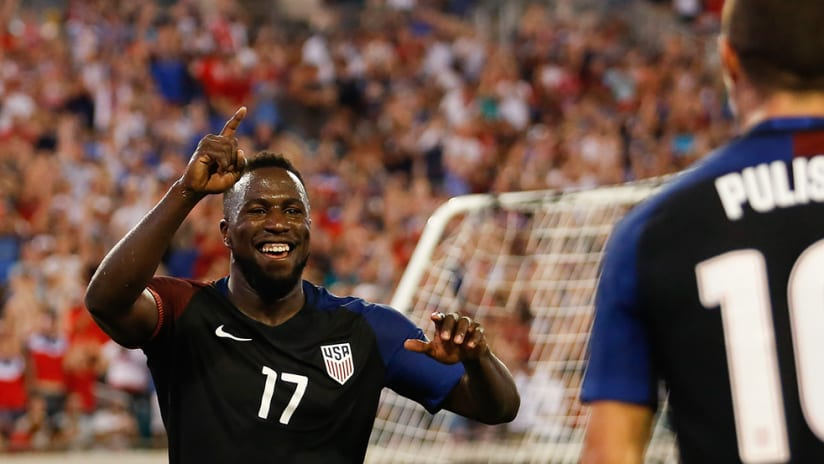 Jozy Altidore - US national team USMNT - smiling at Christian Pulisic