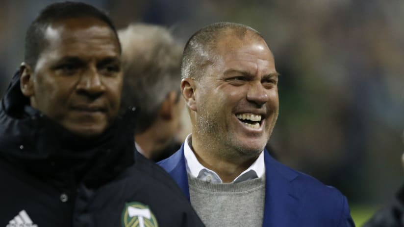 Giovanni Savarese - grinning - surrounded by Portland Timbers coaches