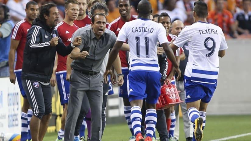 FC Dallas' Oscar Pareja and Fabian Castillo celebrate