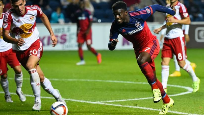 Jason Johnson of the Chicago Fire tries to dribble upfield