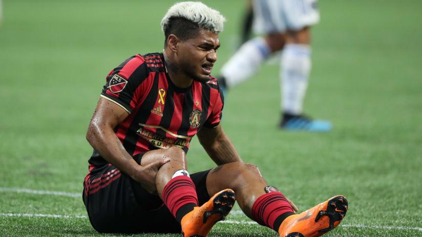 Josef Martinez - Atlanta United - holds his knee after injury