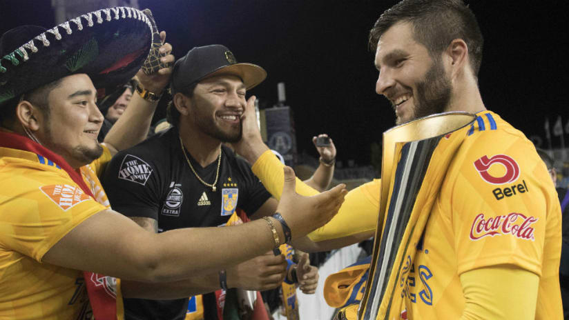 Andre-Pierre Gignac - celebrates Campeones Cup - with fan
