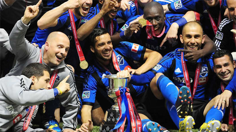 Montreal Impact celebrate their Voyageurs Cup title for winning the Amway Canadian Championship