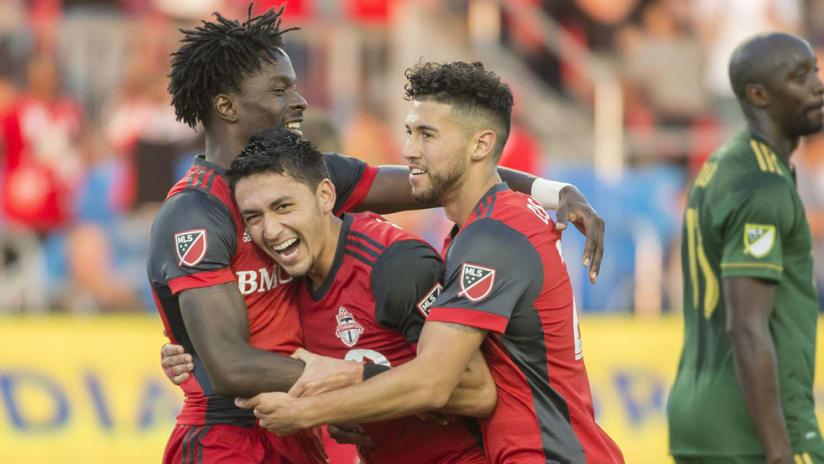 Tosaint Ricketts - Marco Delgado - Jonathan Osorio - celebrate a goal for Toronto FC