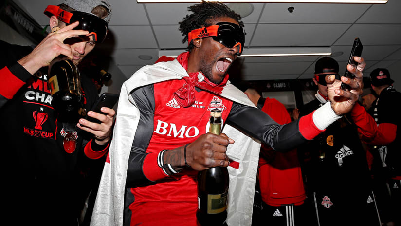 Tosaint Ricketts - Toronto FC - with goggles, champagne and phone during MLS Cup celebrations