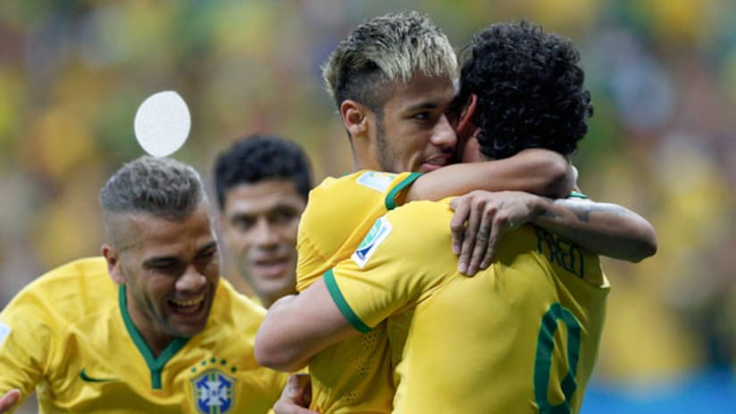 Brazil's Fred (R) celebrates his goal against Cameroon with teammates Neymar (2nd R) and Dani Alves