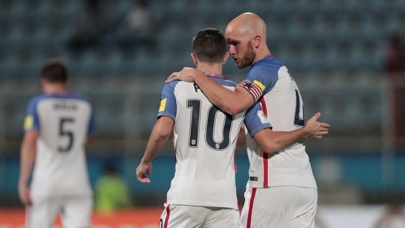 Michael Bradley, Christian Pulisic - US national team - whisper, embrace