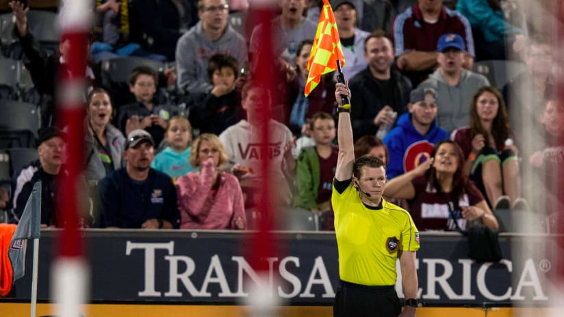Assistant Referee raise flag -- offsides