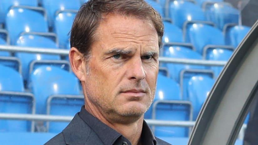 Frank de Boer - scowling - blue seats