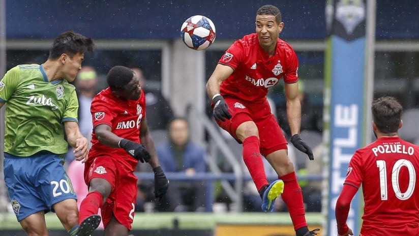 Justin Morrow - Toronto FC - heads the ball against Seattle in a 2019 regular season game