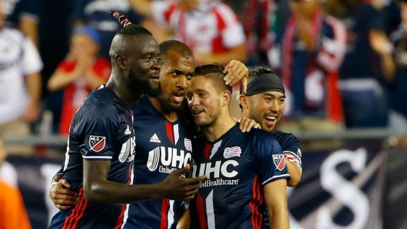 Teal Bunbury - New England Revolution - congratulated by teammates after scoring