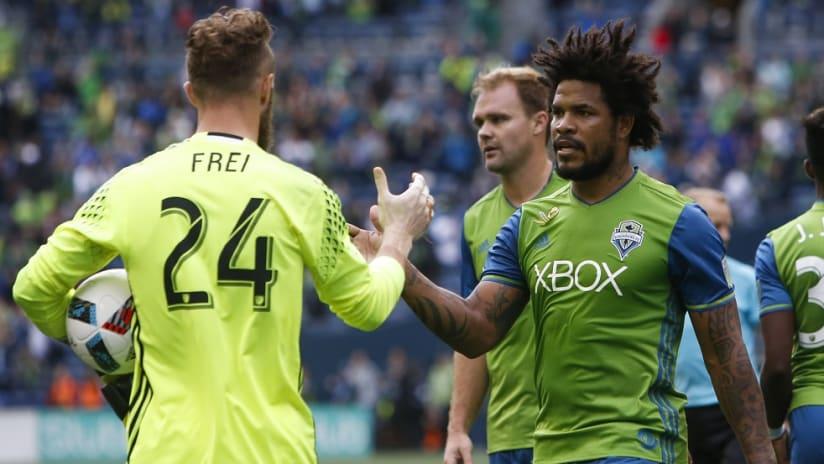 Roman Torres high fives Stefan Frei - 10/11/16