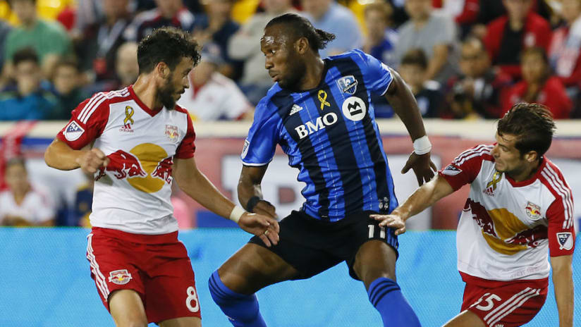 Felipe and Didier Drogba battle for ball-NY-MTL-9.23.16