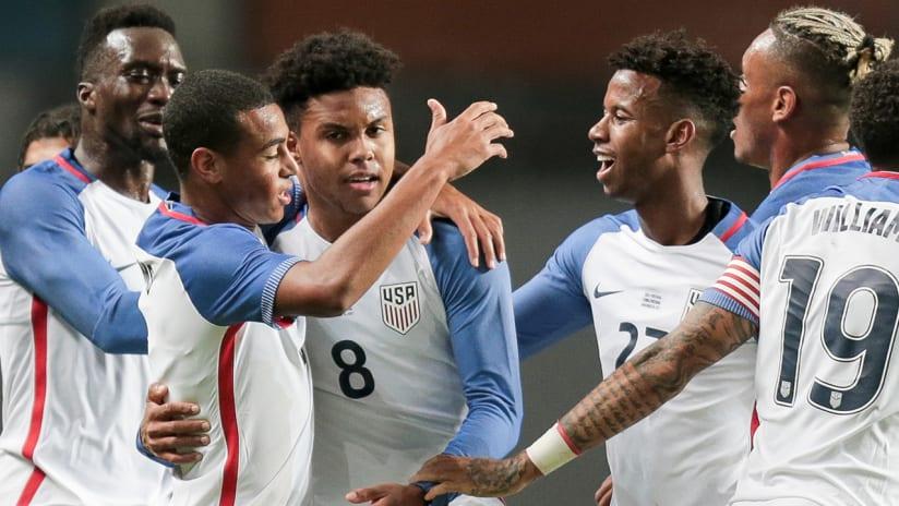 Weston McKennie, Tyler Adams, Kelyn Acosta - US national team - celebrate vs. Portugal