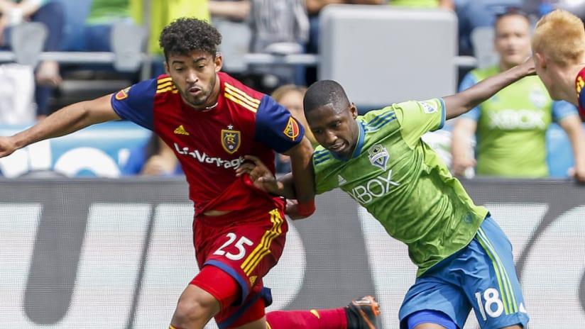 Danilo Acosta battles Kelvin Leerdam for the ball