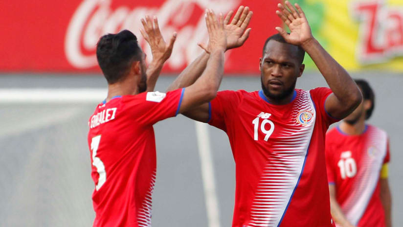 Kendall Waston - high fives during a Costa Rica game