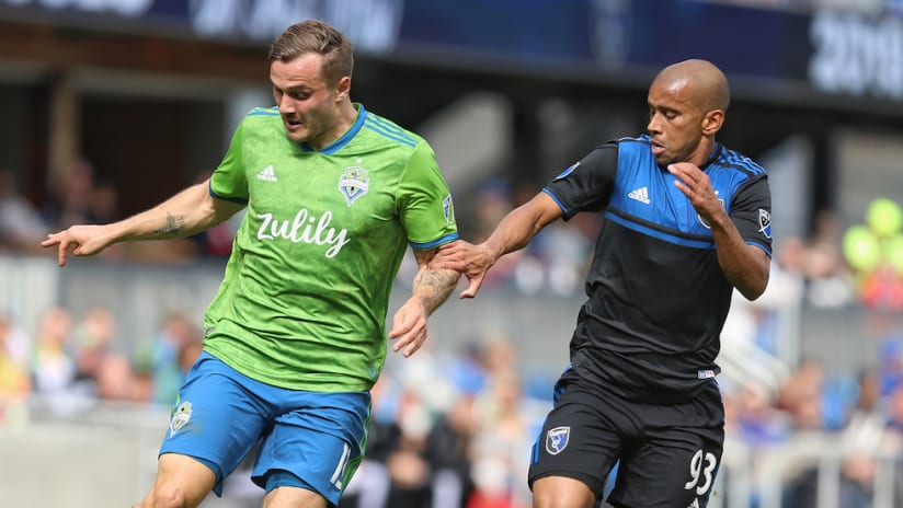 Jordan Morris challenged by Judson