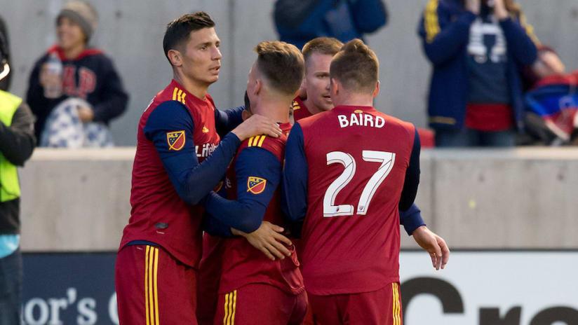 Real Salt Lake attackers hug post goal vs. DC United