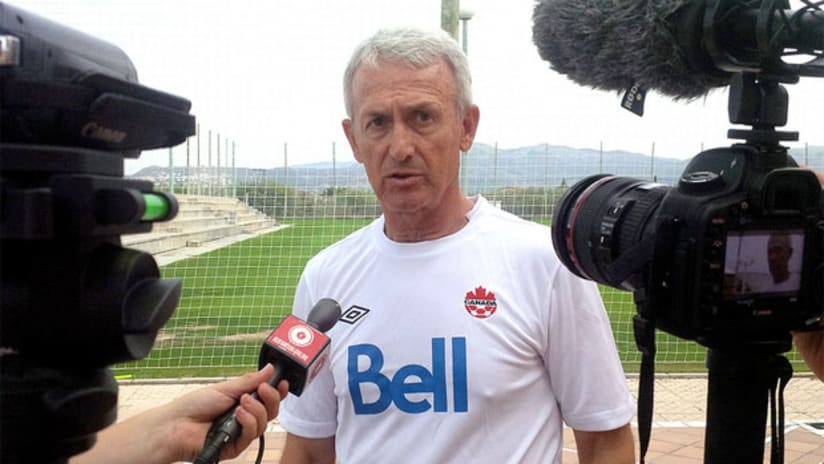 Canada national team coach Benito Floro speaks with media
