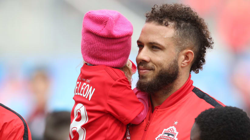 Nick DeLeon and a baby - Toronto FC