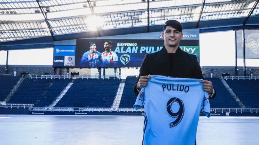 Alan Pulido - holds jersey - Livestrong Sporting Park