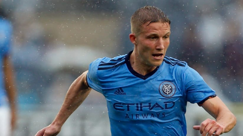 Alexander Ring - New York City FC - passes the ball in the pouring rain