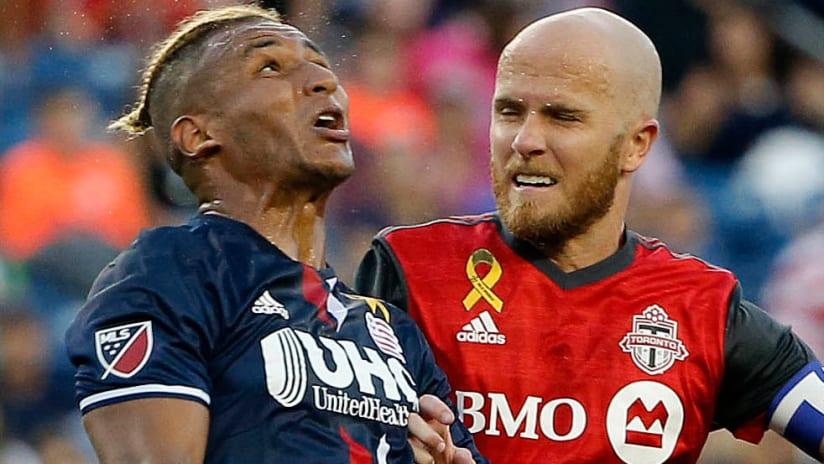 New England Revolution's Juan Agudelo and Toronto FC's Michael Bradley
