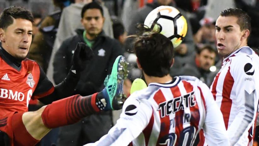 Marky Delgado clears ball from Rodolfo Pizarro-CCL final, leg one