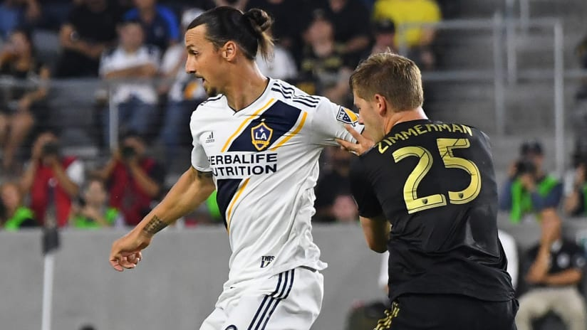 Zlatan Ibrahimovic - LA Galaxy - shields the ball from Walker Zimmerman - LAFC