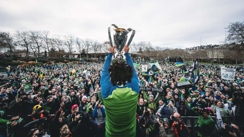 Roman Torres - SEA - shows fans the MLS Cup at Seattle victory parade