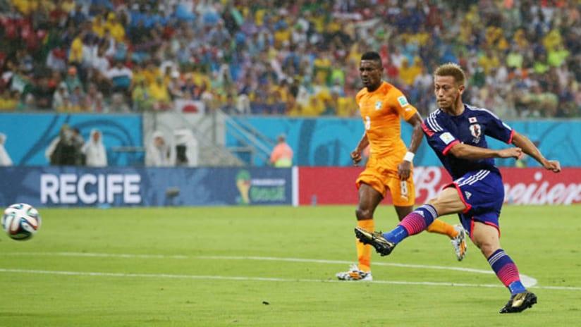 World Cup: Japan's Keisuke Honda strokes home a goal vs. Ivory Coast.