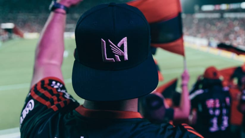 Fan with LAFC hat at Xolos game