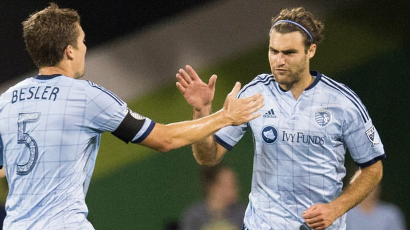 Matt Besler and Graham Zusi high-fiving — Sporting Kansas City —August 22, 2015