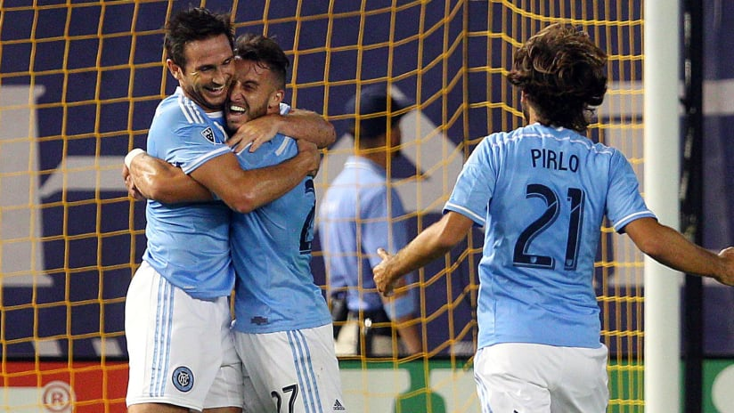 Frank Lampard and RJ Allen hug after Lampard scores a goal for New York City FC