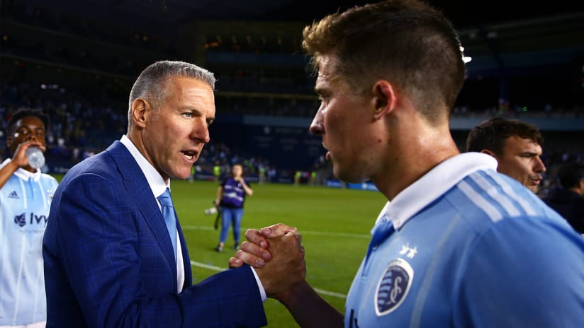Peter Vermes, Matt Besler - Sporting Kansas City - bro handshake