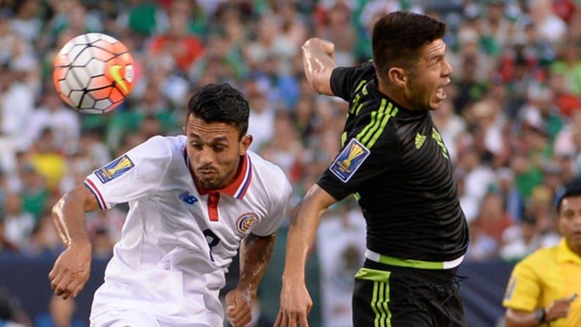 Oribe Peralta and Giancarlo Gonzalez contest a header