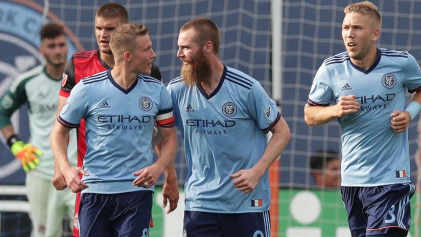 Alex Ring, Jo Inge Berget and Anton Tinnerholm celebrate a New York City FC goal vs. Toronto