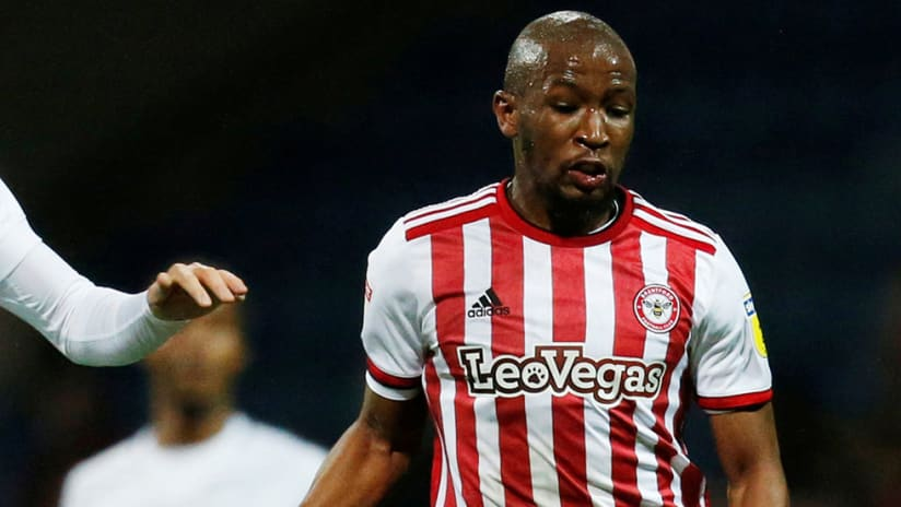 Kamohelo Mokotjo - Brentford - fends off challenge