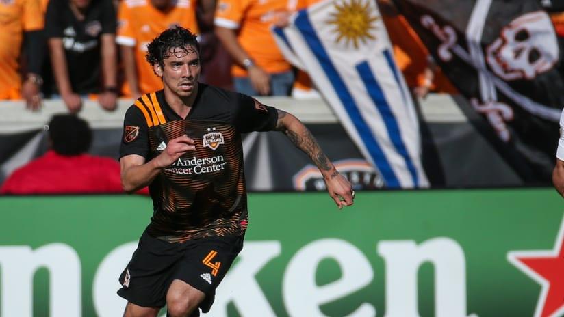 Zarek Valentin on the ball