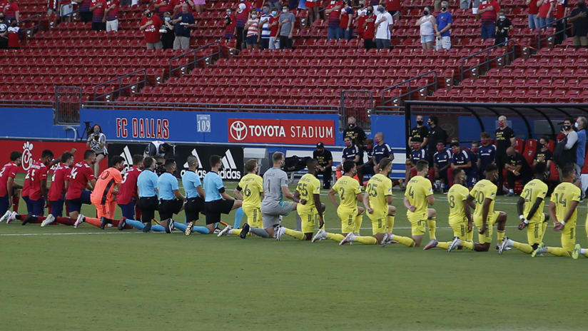 FC Dallas - Nashville SC - players keeling anthem