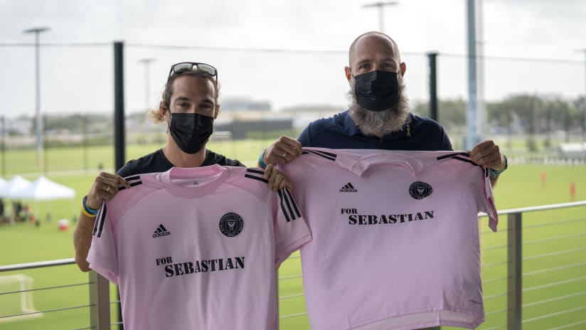 """Sebastian Ortiz's uncle Alex (left) and dad Oscar (right) pose with the """"For Sebastian"""" Inter Miami training tops."""